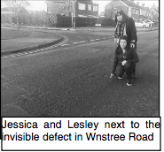 Lesley and Jessica point to dangerous potholes